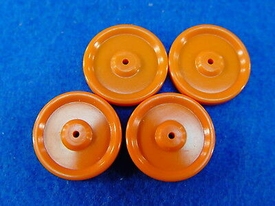 Old Store Stock!  4 One Inch Size Plastic Wheels For Candy Containers.  Orange!