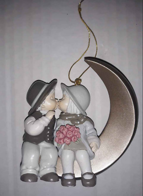 Kim Anderson's Pretty as a Picture Couple on Moon Christmas Ornament boy & girl