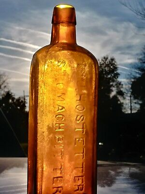 Bitters slight amber yellow color  vintage antique old