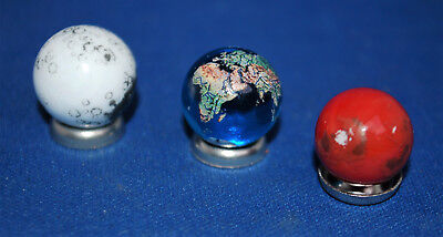 An unusual set of three small glass planets, planetarium, with stands