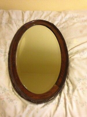 Old Wooden Wavy Edged Framed Oval Bevel Edged Wall Mirror