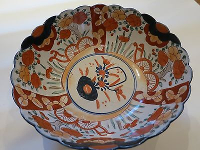 An antique Japanese Imari porcelain bowl 19th c Meiji period with fluted edge