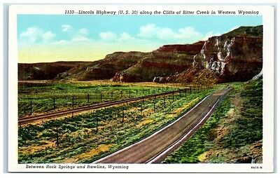 Mid-1900s Lincoln Highway (US Hwy 30) along Bitter Creek Cliffs, WY Postcard