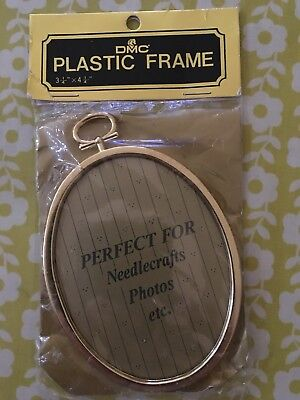 Small DMC gold plastic oval frame with hanger for needlecrafts or photos 3 1/4""