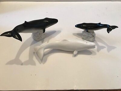 Small, hand-carved Fin, Beluga and Minke whales by G. Harrington