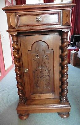 Antique carved cabinet with marble top and barley twist columns