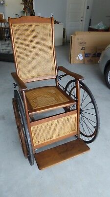 Vintage antique oak and cane wheelchair with all original hardware, wheels