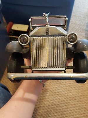 Two Decanter holders, vintage cars Rolls Royce(1) and Ford(1)