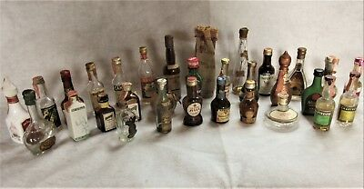 31 Vintage Miniature Glass Liquor Bottles, some with Tax Stamps