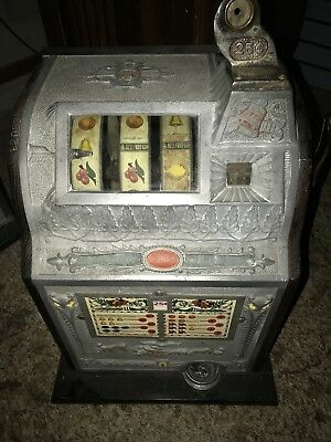 Antique Mills Owl 25 Cent Slot Machine needs to be serviced.  FREE SHIPPING
