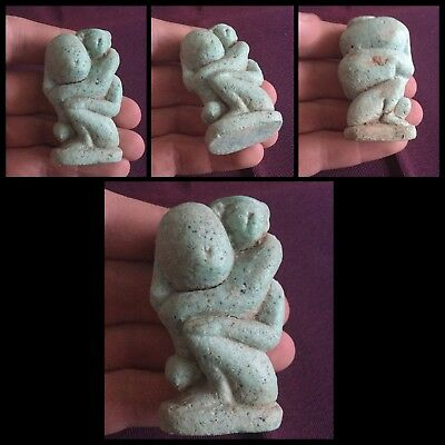 Rare ancient Egyptian erotic blue faience phallic holding amulet . 3000 bc .