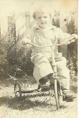 real photo child on tyricycle