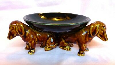 DACHSHUND. vintage trinket dish with 3 sitting Dachshunds as the feet. VERY RARE