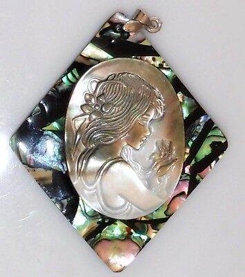 Mother of pearl carved cameo pendant w/natural abalone and black onyx