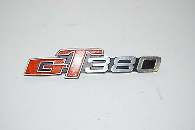 Suzuki GT380  EMBLEM Side cover  Orange Flake nos  GENUINE  68141-33000