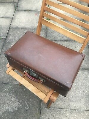 True small vintage leather suitcase