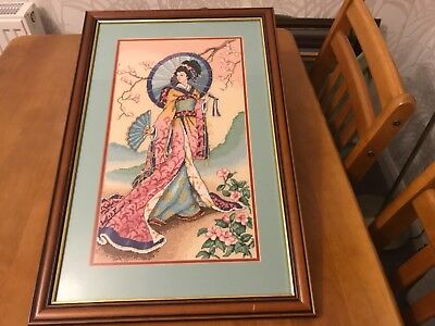 commanding cross stitch of a beautiful oriental elegant lady holding a parasol
