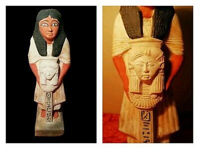 Ancient Egyptian statue of a dignitary holding a standard of the head of Hathor