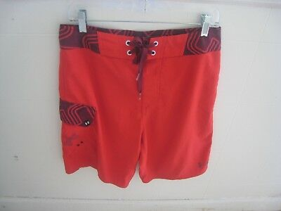 3c00cb0f4730b MENS UNDER ARMOUR Loose Red   Blue Unlined Swim Trunks Board Shorts ...