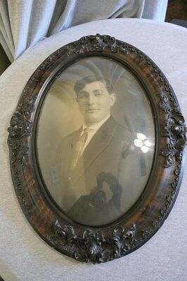 "Large Antique Carved Tiger Wood Convex Bubble Glass Frame - Man in Suit 25"" H"