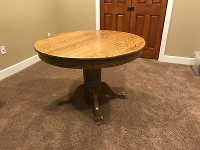 """Antique Claw Foot Oak 42"""" round dining table expands to 72"""" oval  LOCAL PICK UP"""