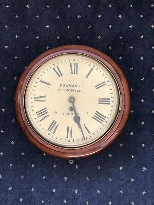 Chain Fusee wall clock with 12 inch dial beveled glass and mahogany surround.