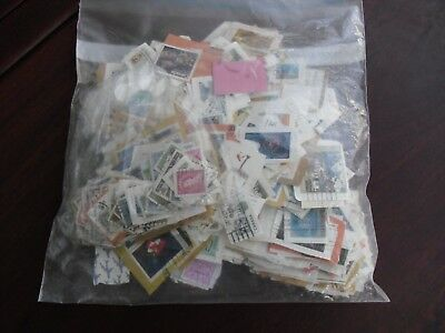Over 1000 Stamps Lot Worldwide on paper many countries Phllatellly Collectors