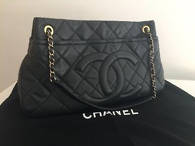 3b8398852e48 CHANEL DARK BLUE-BLACK Quilted Caviar Brushed Gold Charm Tote Bag ...