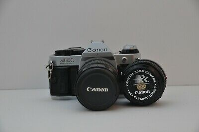 Canon AE-1 Program Film Camera with Two Lenses