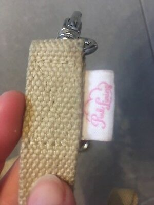 Pink lining push chair straps/clips