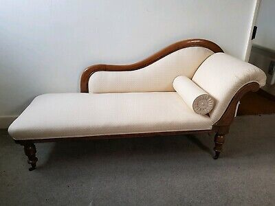 Antique chaise longue with matching bolster cushion