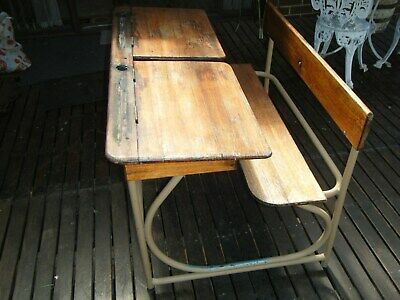 Vintage old wooden two seater double school desk with metal frame