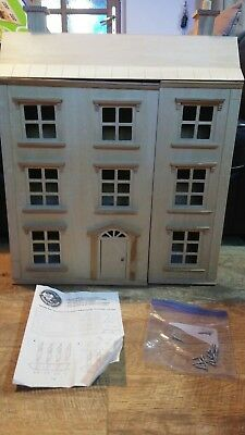 * Classic four storey wooden dolls house with all furniture with people *