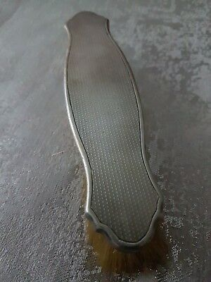 A Stirling Silver Clothes Brush