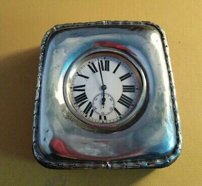 Old silver cased goliath travel clock.