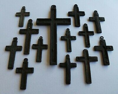 A rare lot of 13 bronze crucifixes / crosses from the 16th. / 17th. century.