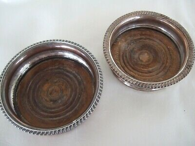 Two Victorian antique wine coasters silver plate with wood bottoms A
