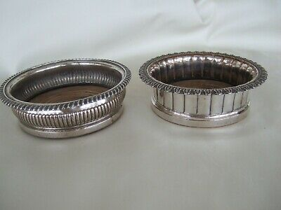 Two Victorian antique wine coasters silver plate with wood bottoms B