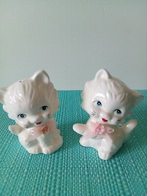 White cats with pink bows Salt And Pepper Shakers.