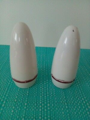 White and maroon Salt And Pepper Shakers.