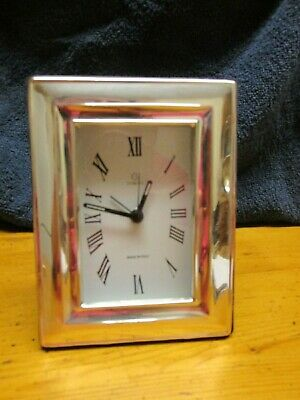 Silver framed battery operated alarm clock