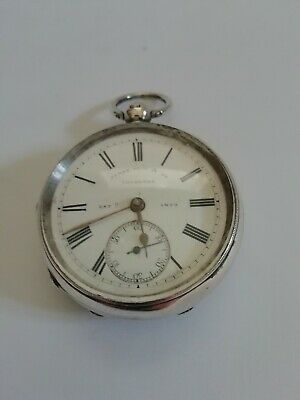 Antique silver pocket watch working with key. James Reid & Co 1897