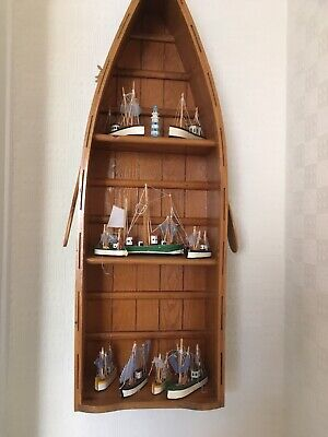 Wooden Boat Shaped Shelving Unit With 9 Miniture Fishing Boats & Lighthouse.