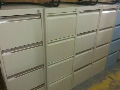 Four Drawer Filing Cabinet lockable with key.