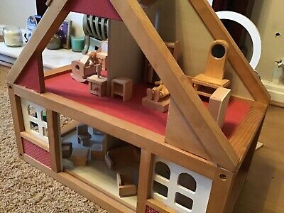 wooden dolls house with lots of furniture and 2 dolls collect liverpool