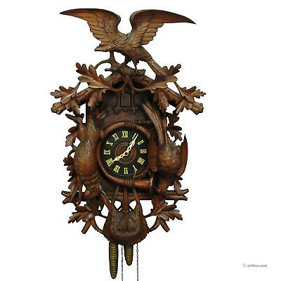 black forest carved wood cuckoo clock with large eagle on top