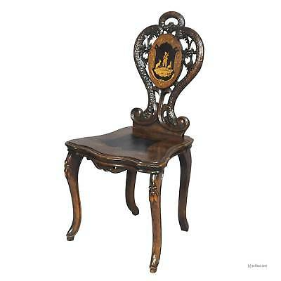 a black forest carved and inlaid walnut chair, swiss 1900