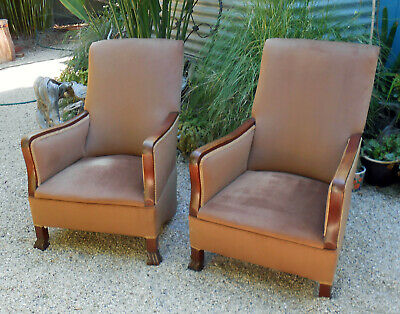 Antique/vintage spring based rocking chairs, hardwood arms and legs.