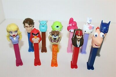Pez Dispensers Bulk Lot Hello Kitty Star Wars Monster Inc Taz Etc...