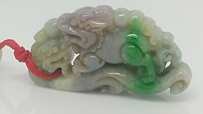 A very old and very beautifully carved jadeite Pendant, A Double Pixiu Grade A